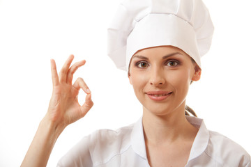 Chef baker or cook showing ok hand sign, isolated on white