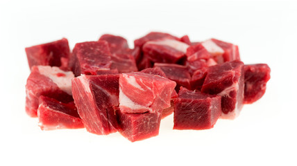 Diced chunks of raw lamb and mutton meat isolated on white