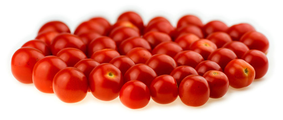 Juicy cherry tomatoes isolated against a white background