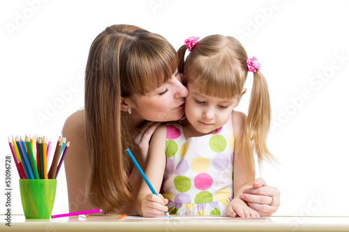 mother and her child girl draw together