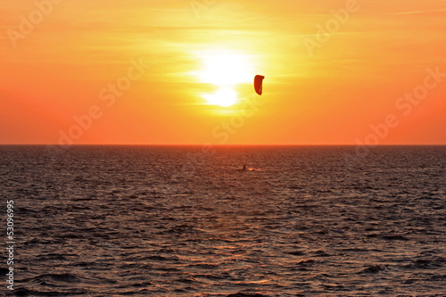kitesurfer at sunset
