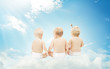 Baby back in diapers sitting on clouds over sky background