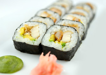 Fried breaded chicken sushi rolls with wasabi and ginger