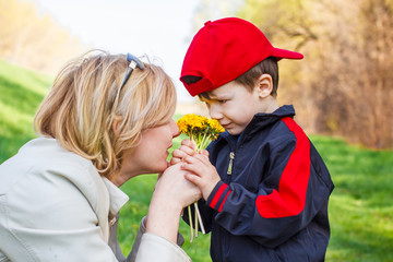 Mother and little boy with flower