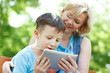 Happy mother and son with tablet