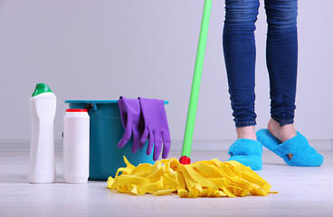 Cleaning floor in room close-up