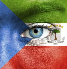 Human face painted with flag of Equatorial Guinea