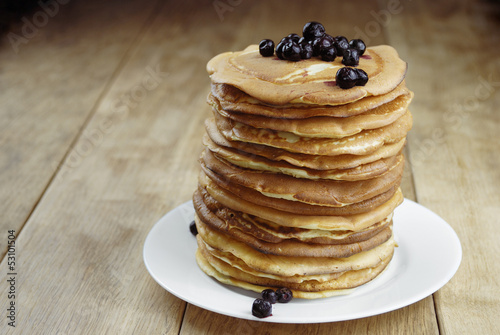 Pile of pancakes in the white plate