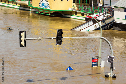 Traffic light and road signs on Terassenufer during inundation o