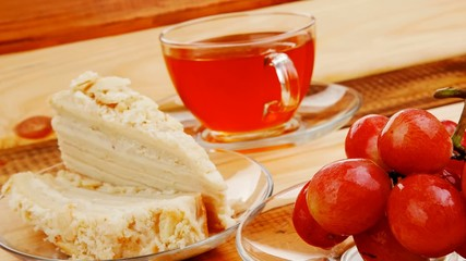 cream cake with tea and grapes on wood 1920x1080 intro motion sl