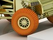 Orange wheel buggy up the stairs