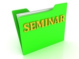 SEMINAR bright yellow letters on a green folder with papers