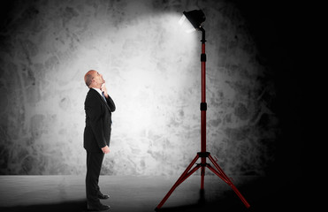 Businessman standing in a spotlight