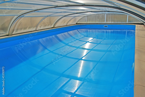 Swimming pool with a roof