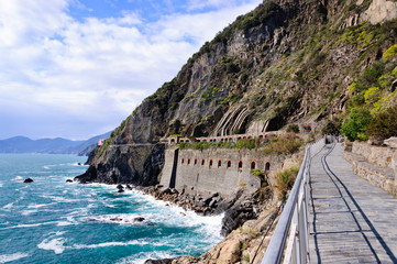 Boardwalk and rocky mountains Via del Amore, Cinque Terre, Italy