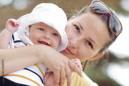 smiling baby on mother's hand's