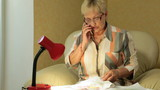 Mature woman is talking by phone