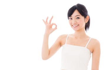 attractive asian woman showing okay sign