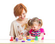 mother and daughter play with dough