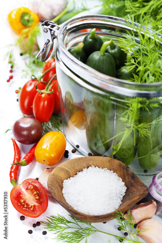 preparing preserves of pickled cucumbers and tomatoes