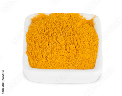Pile of ground turmeric on white