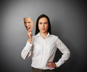 quiet woman holding aggressive mask