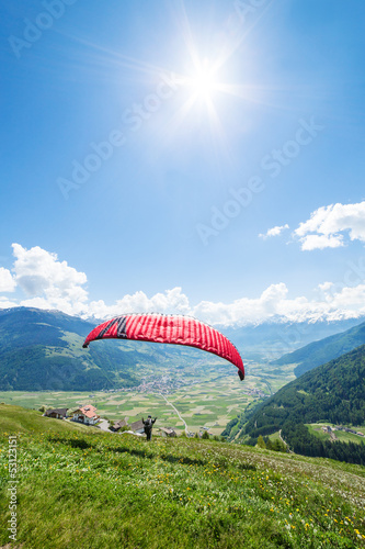 Leinwandbild Motiv Paraglider in the mountains