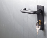 A door handle with lock and keys