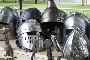 Medieval swords and helmets