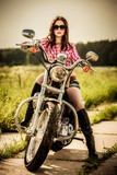 Fototapety Biker girl sitting on motorcycle
