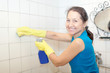 Smiling   woman cleans tile