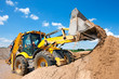 Leinwanddruck Bild - Excavator machine unloading sand during earth moving works