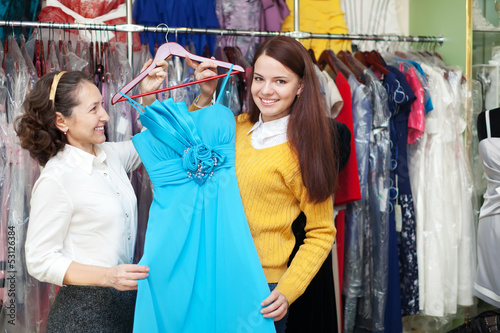 Happy women chooses blue dress
