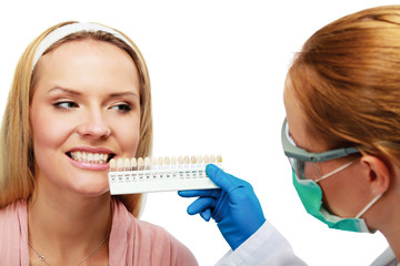 dentist at work on woman patient in office