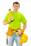worker in green t-shirt with tools