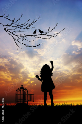 Little girl with bird cage