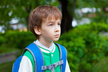 Portrait of serious student with backpack