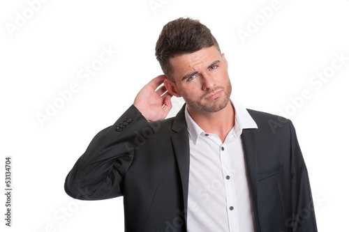 Puzzled modern business man - isolated on white