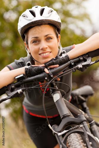 Portrait of woman with mountain bike