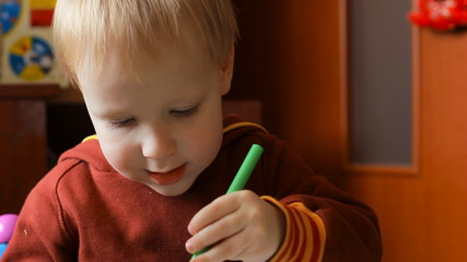 child learns to draw