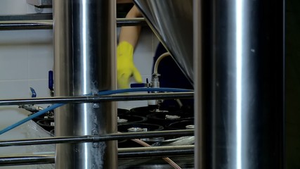 Filling (packaging) fresh beer in a beer kegs at a brewery.