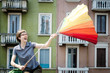 young beautiful hipster woman with colorful umbrella