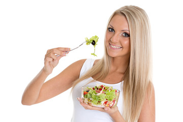 Slender woman holds a bowl of salad.