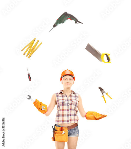 Female manual worker juggling with tools