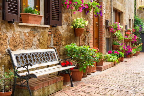 Beautiful street decorated with flowers in Italy - 53136905
