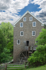 old flour mill powered entirely by wooden water wheel