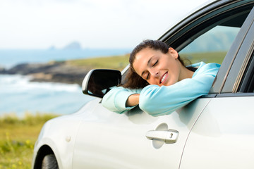 Woman in car on summer travel