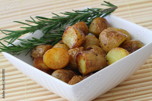 Roasted baby potatoes with fresh rosemary, close up