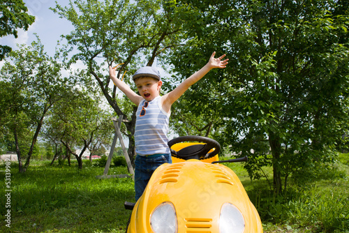Happy child on lawn mower