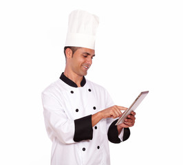 Young male cook using tablet pc